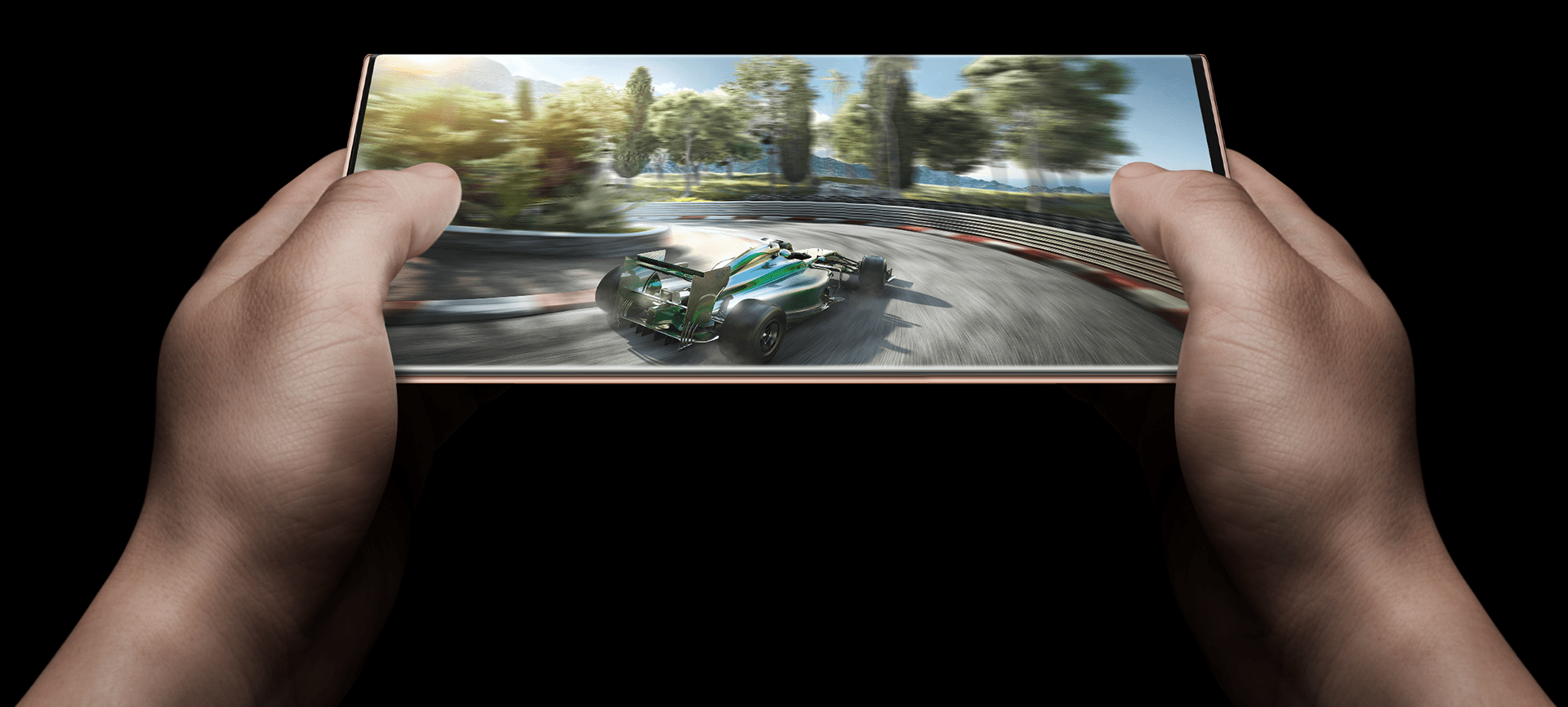 Revolutionary gaming capability with the Samsung Note20 series. A pair of hands, using a Mystic bronze Note20 device in landscape view, playing a high resolution and performance demanding car racing game. Displaying the powerful capabilities of the device.